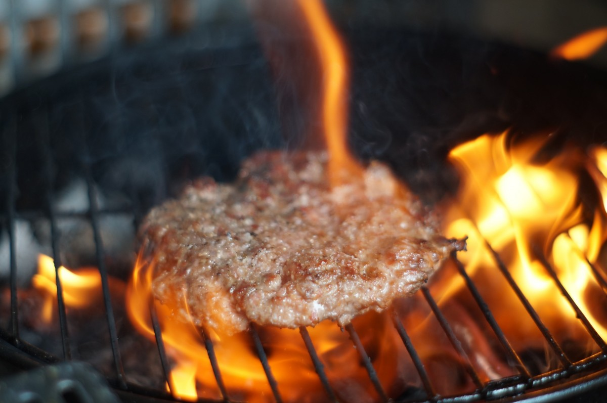 Meat over open flame